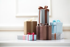 Gift boxes with colorful wrapping paper and ribbons